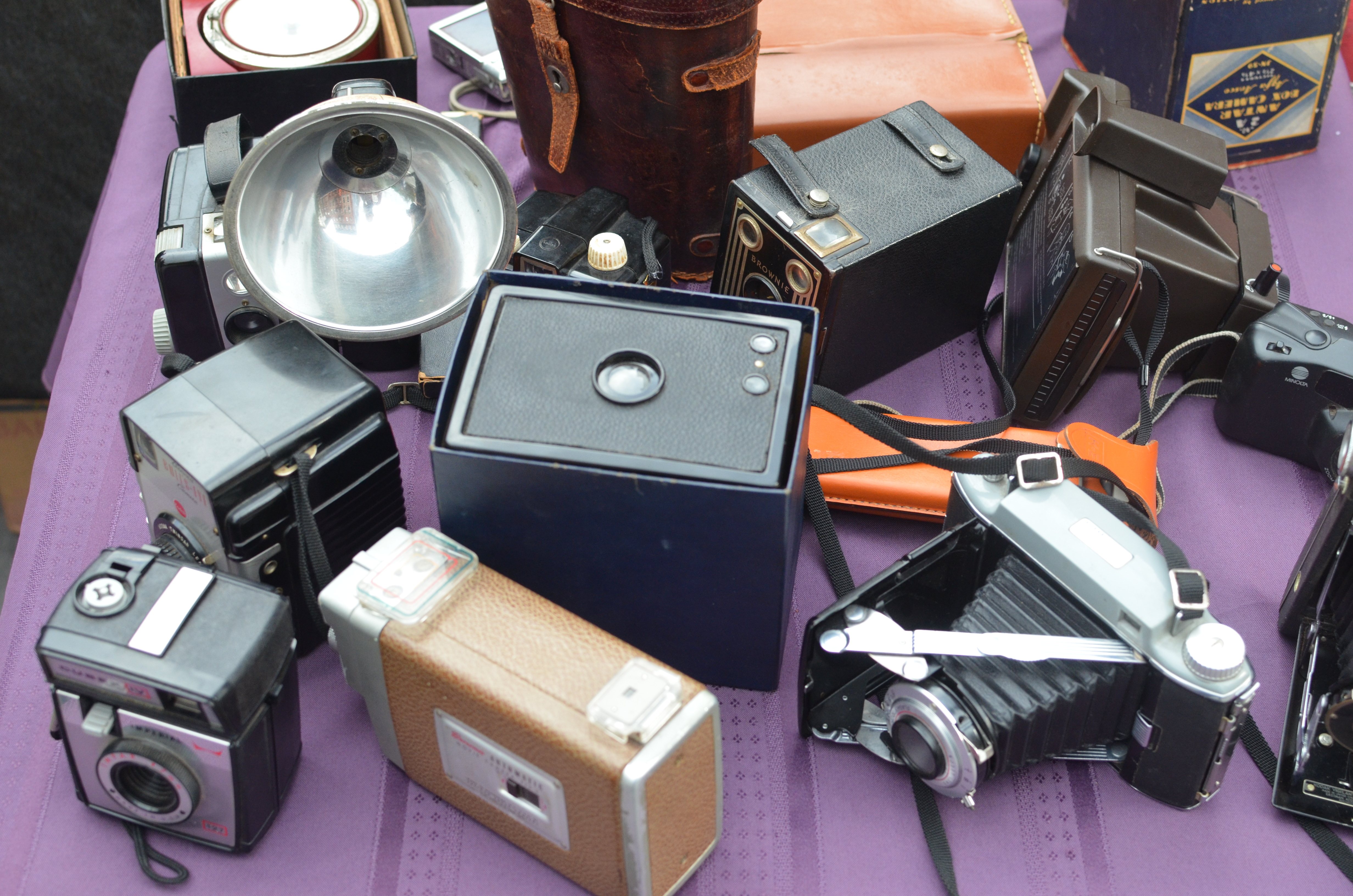 old cameras on a street vendor's table