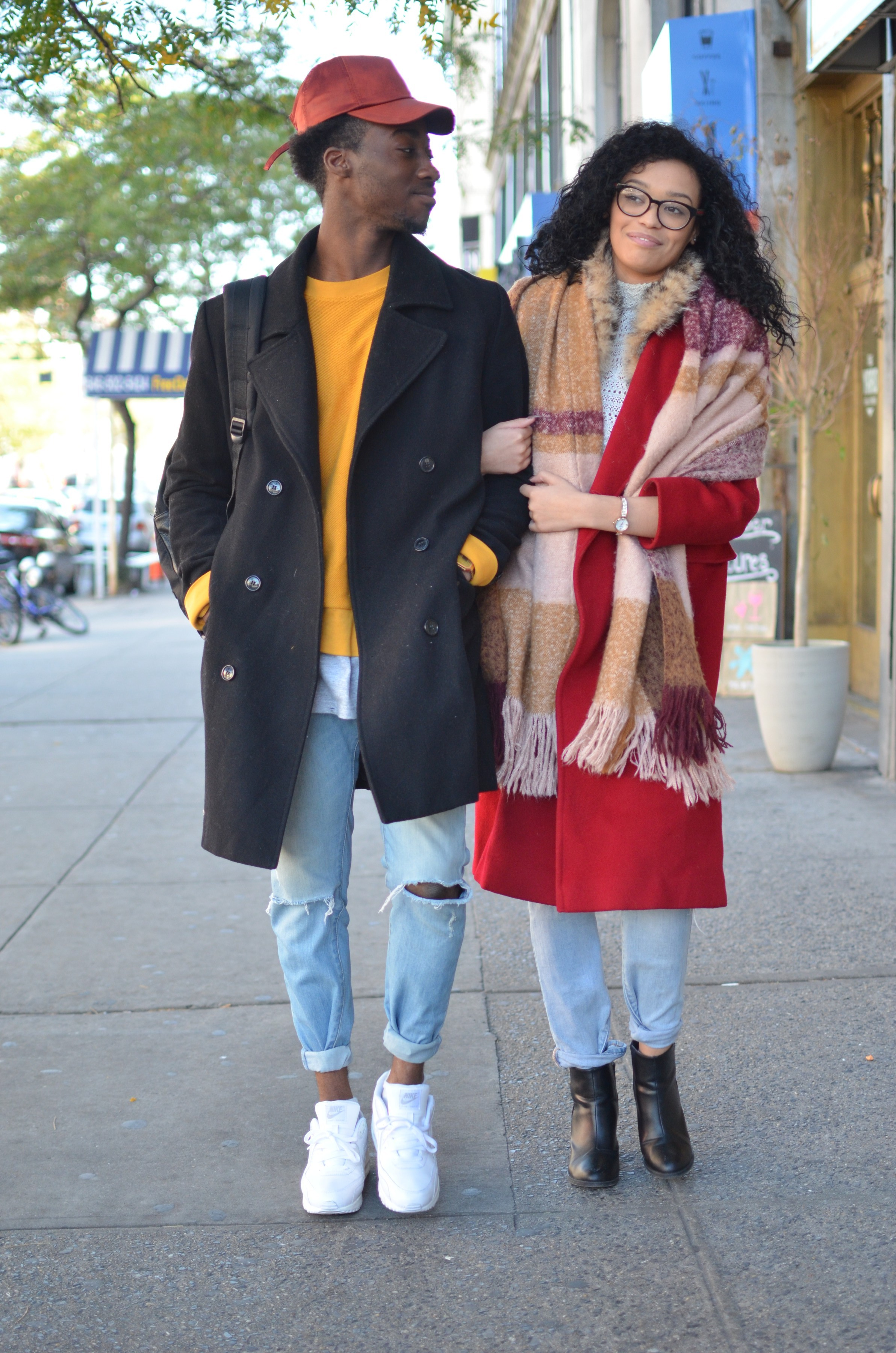 african-american couple in colorful outfits