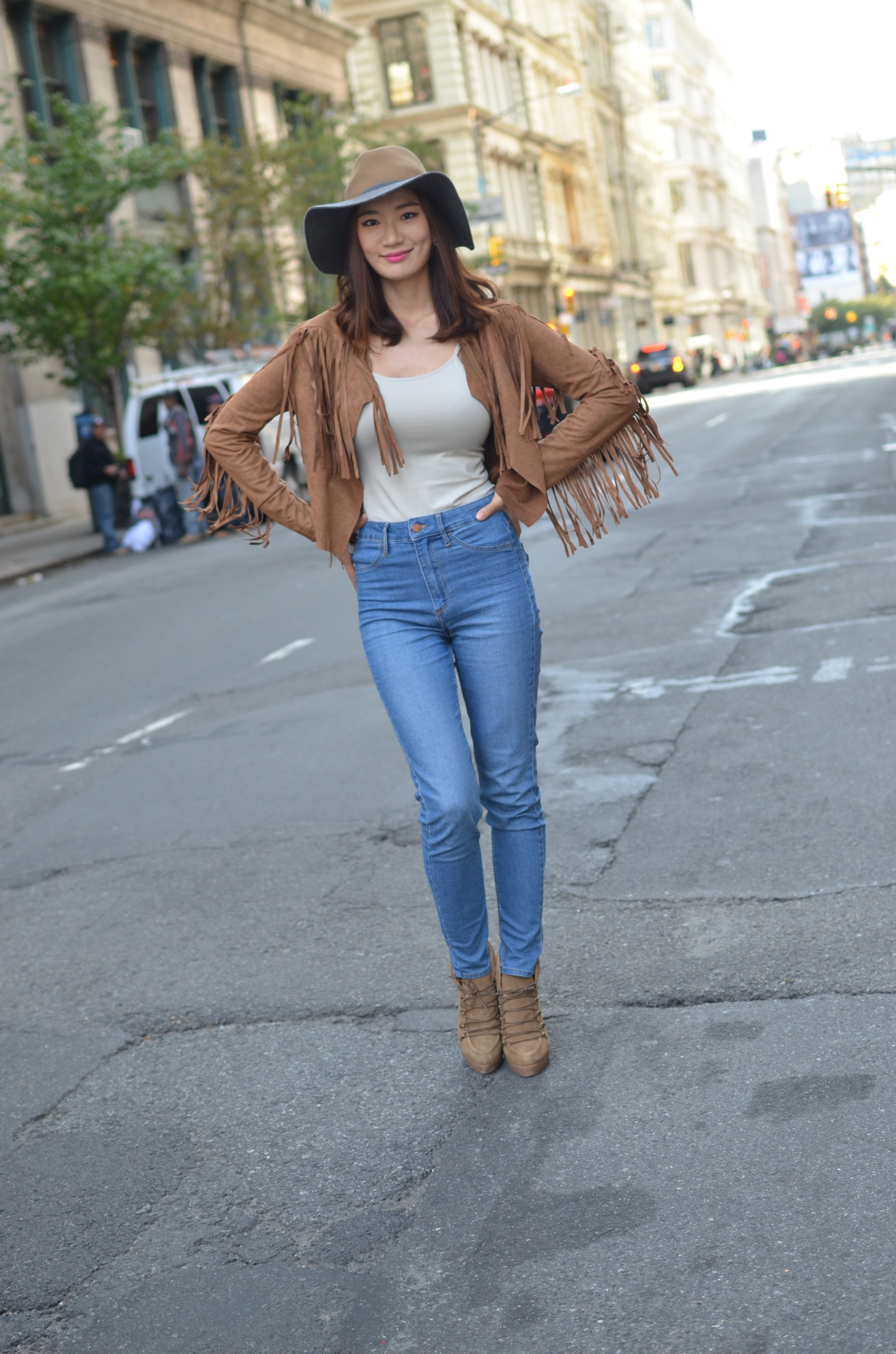 beautiful girl in jeans and fringe jacket