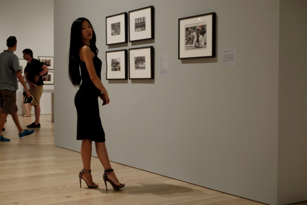 japanese girl in black dress in museum