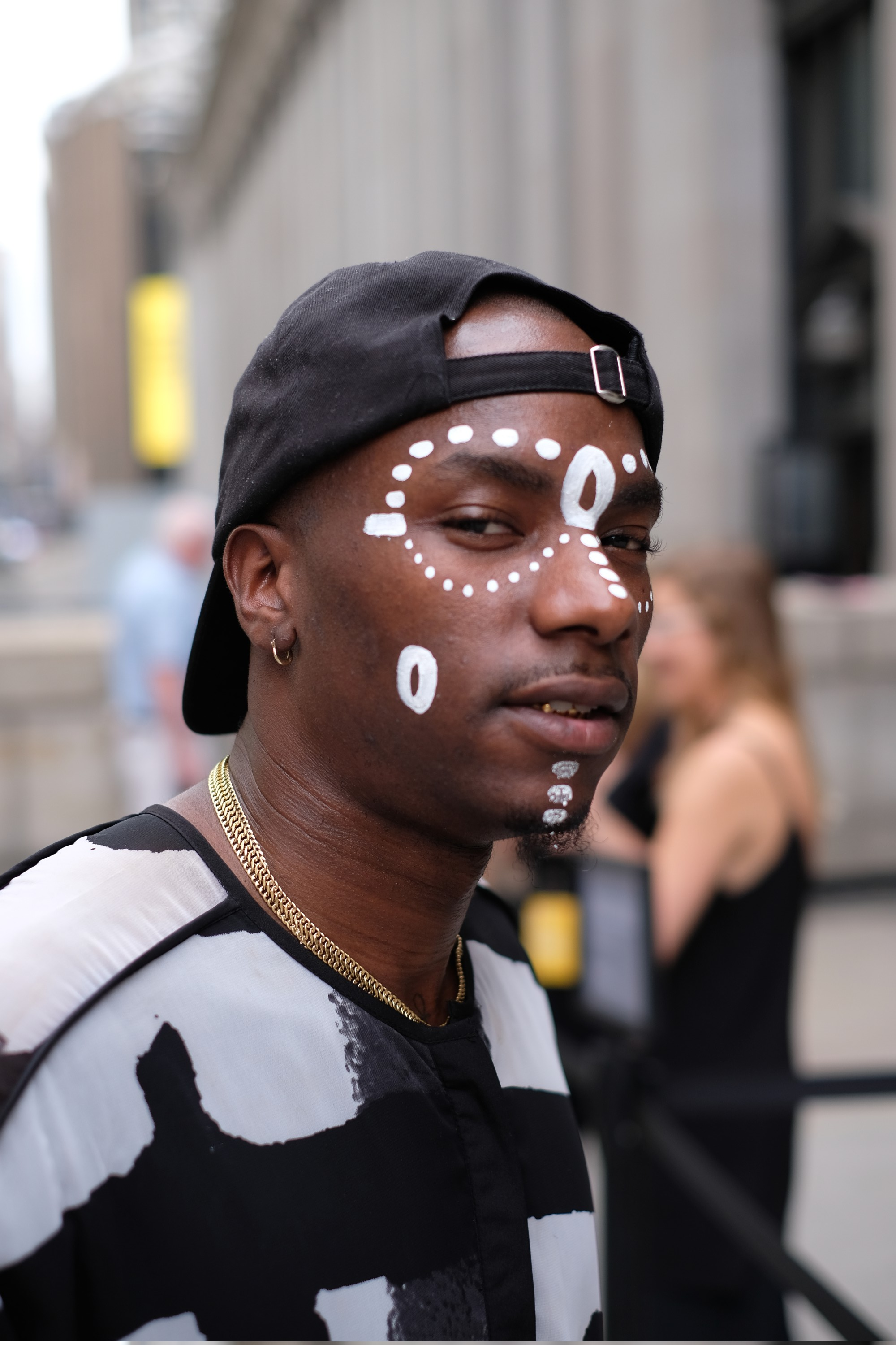 white facial tattoo