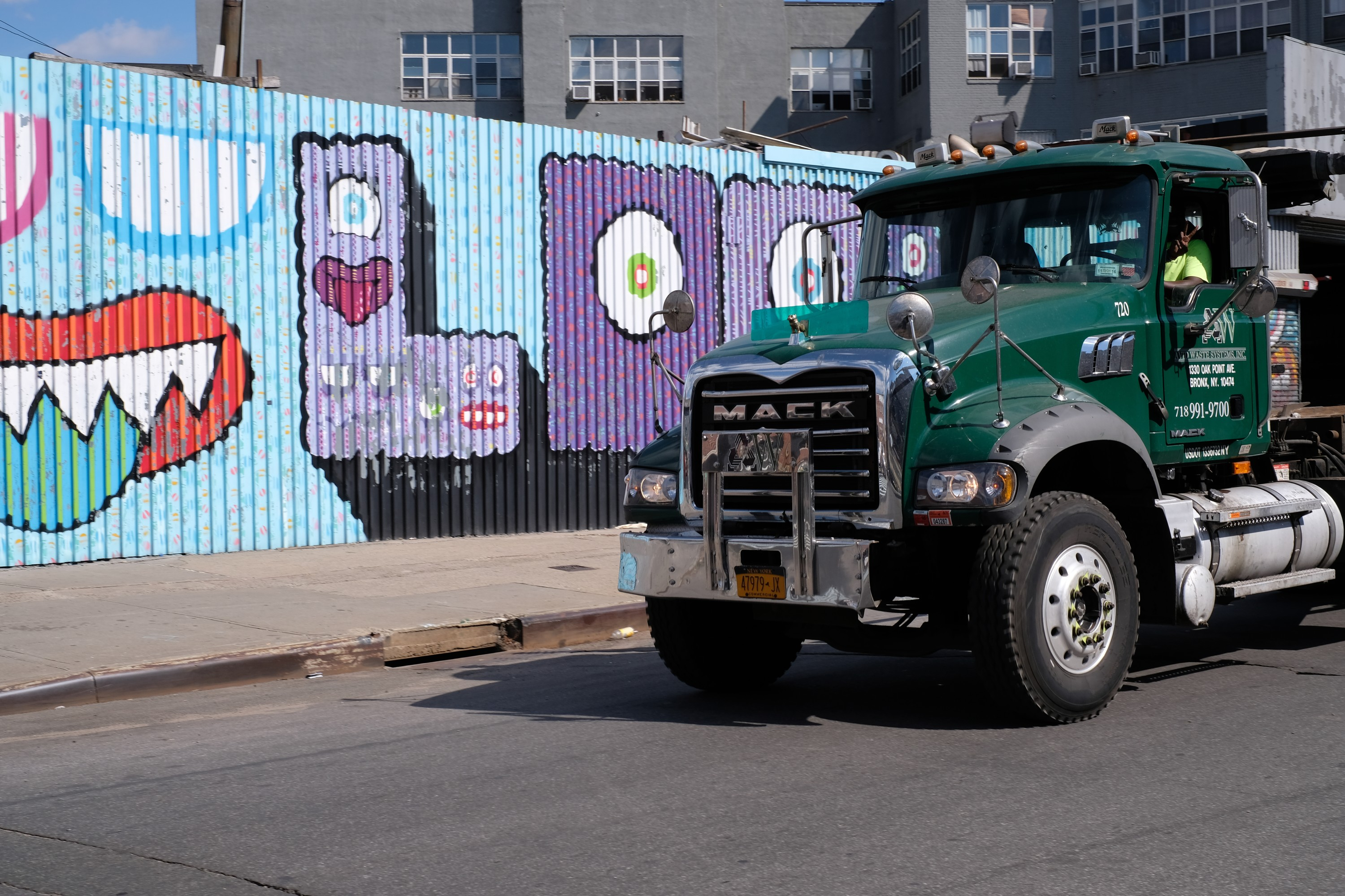 cab of Mack truck by street art