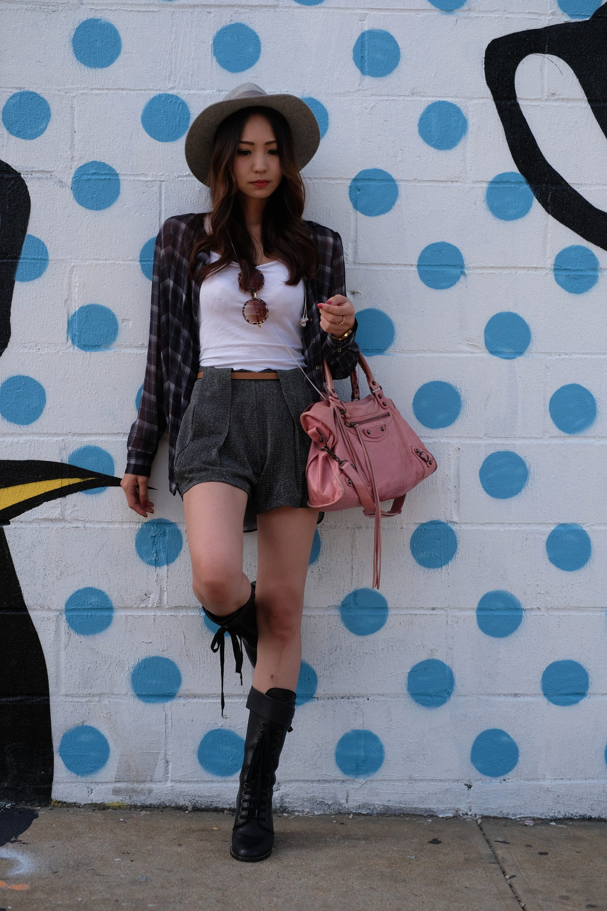 pretty Japanese girl in front of street art