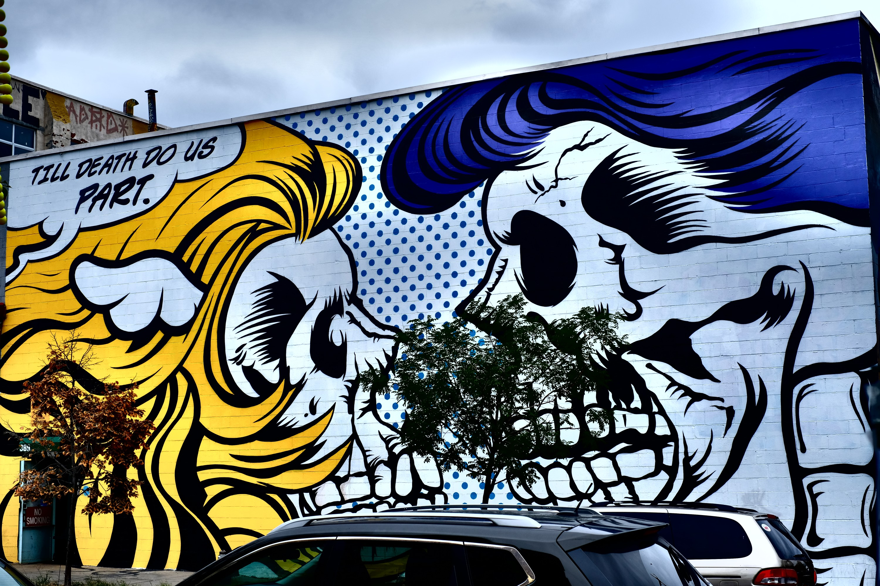 street art of two skulls facing each other