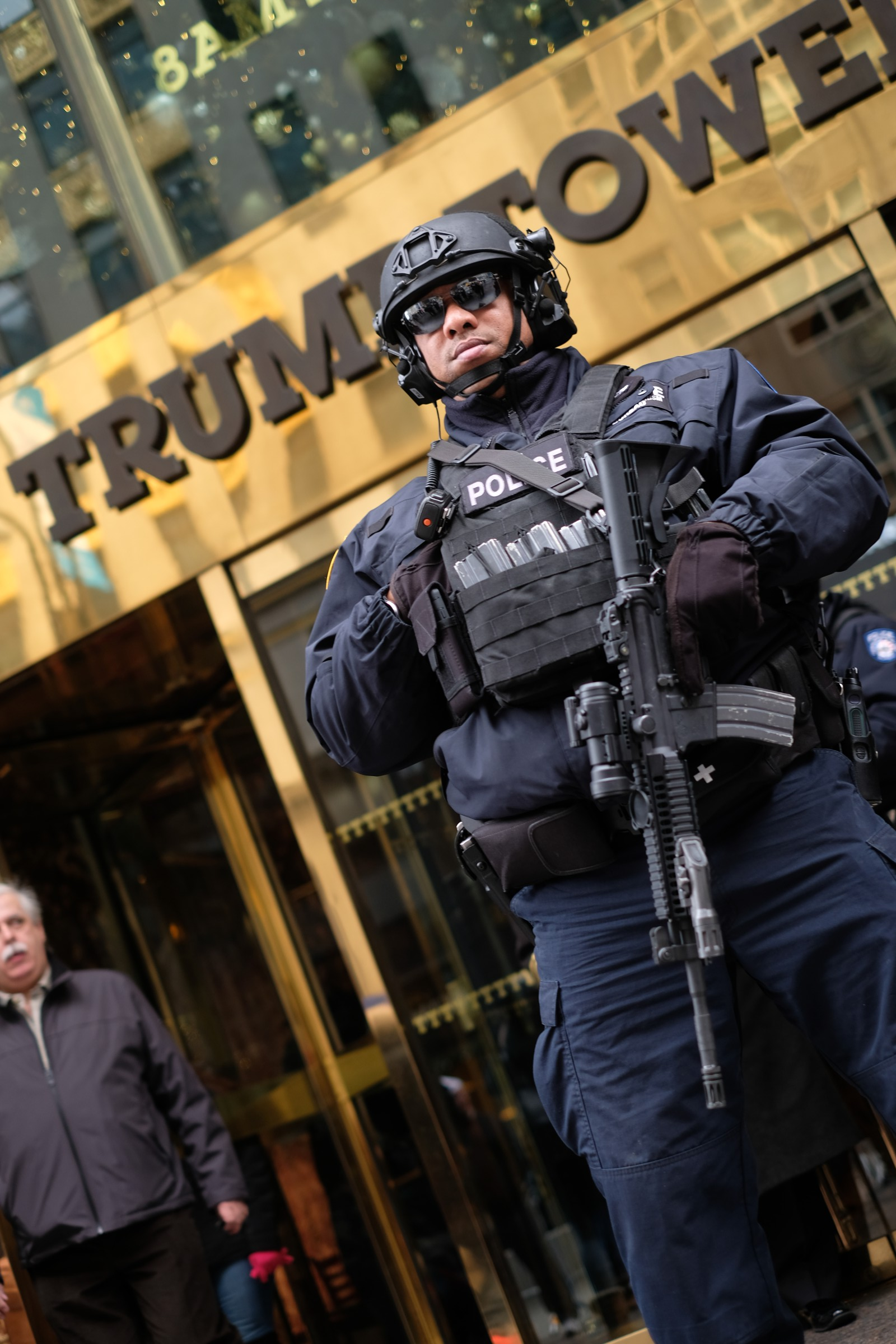 heavily armed policeman at Trump Tower