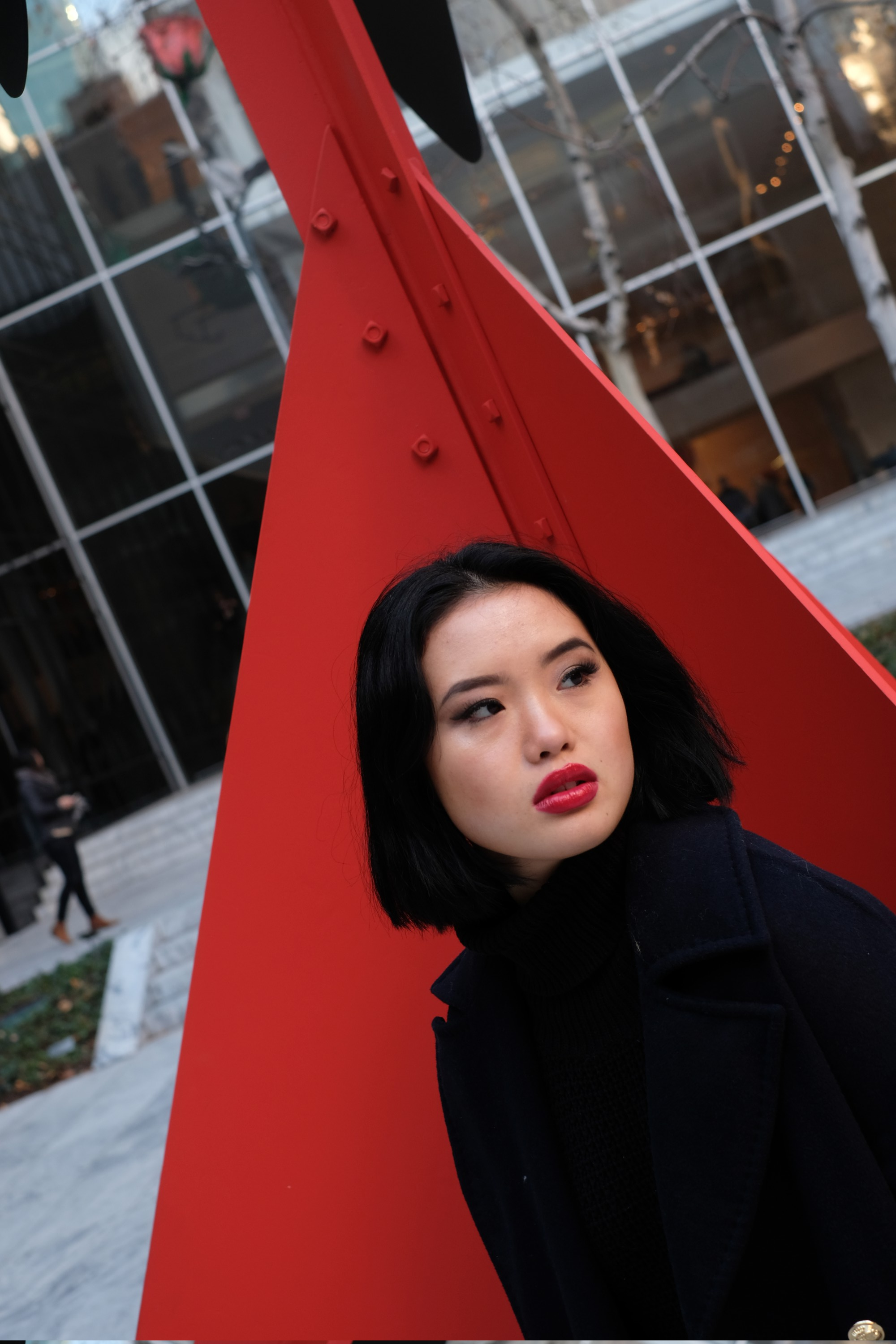 Chinese model by red Calder sculpture