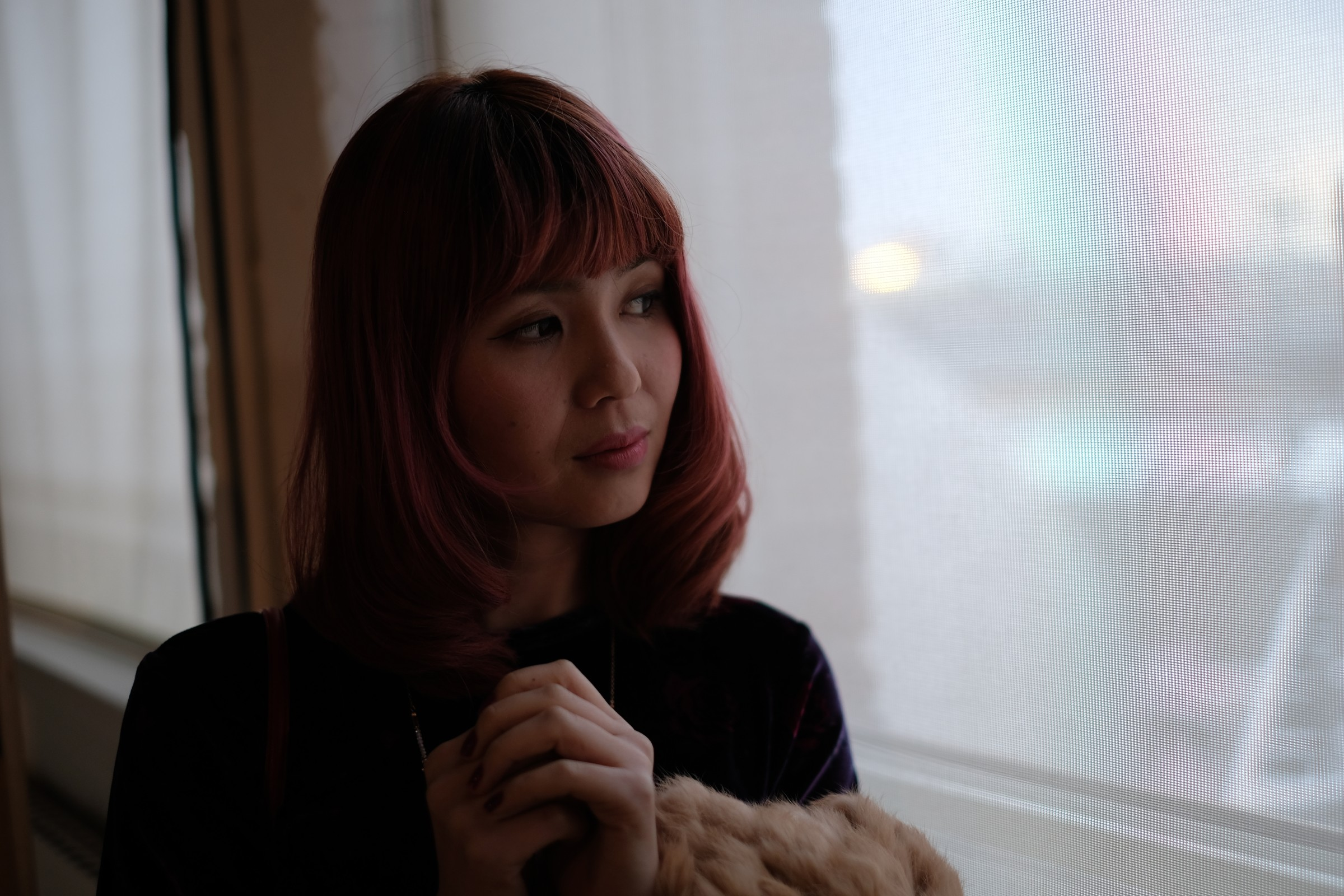 Asian girl by a window