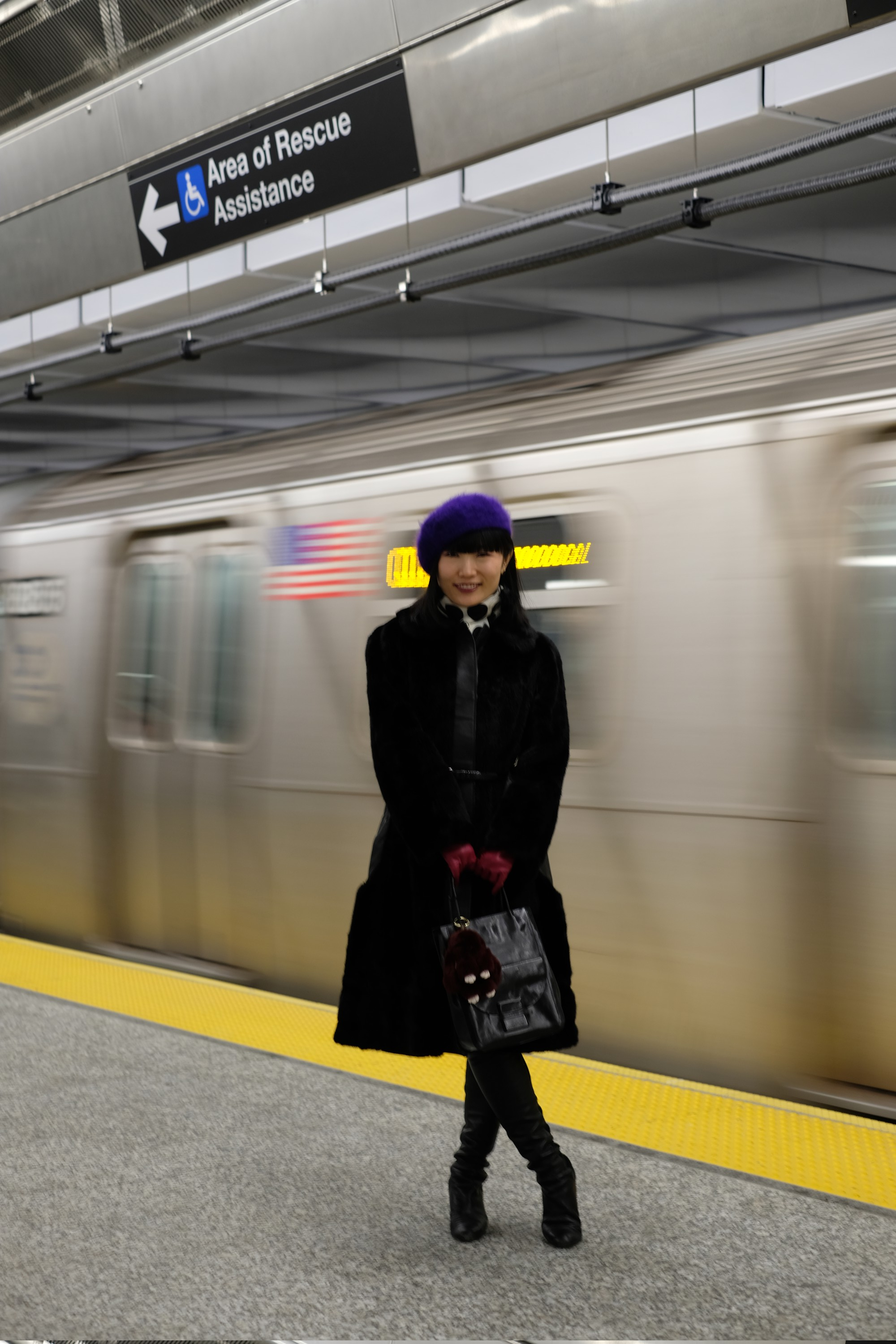 Model standing by moving subway train
