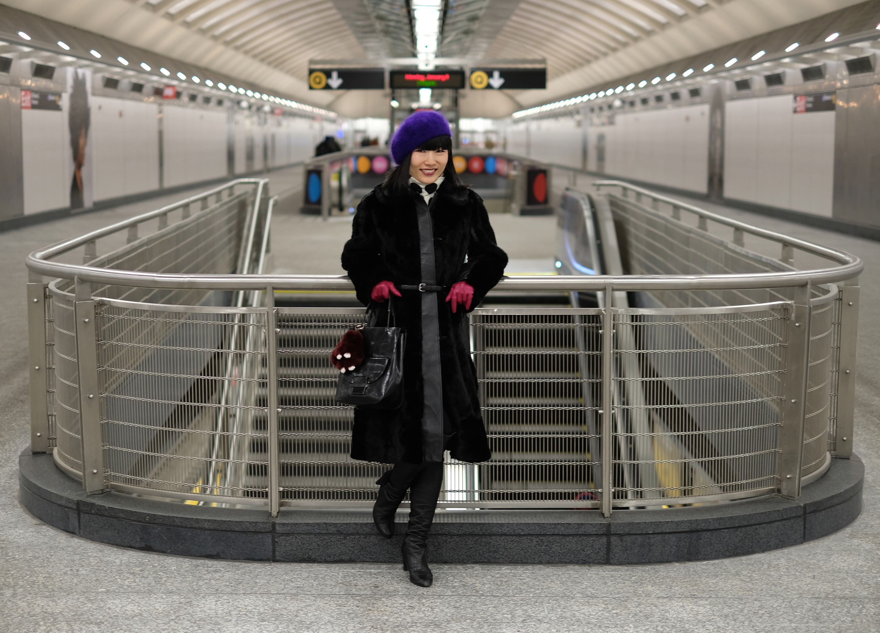 Japanese girl in black coat in new subway station