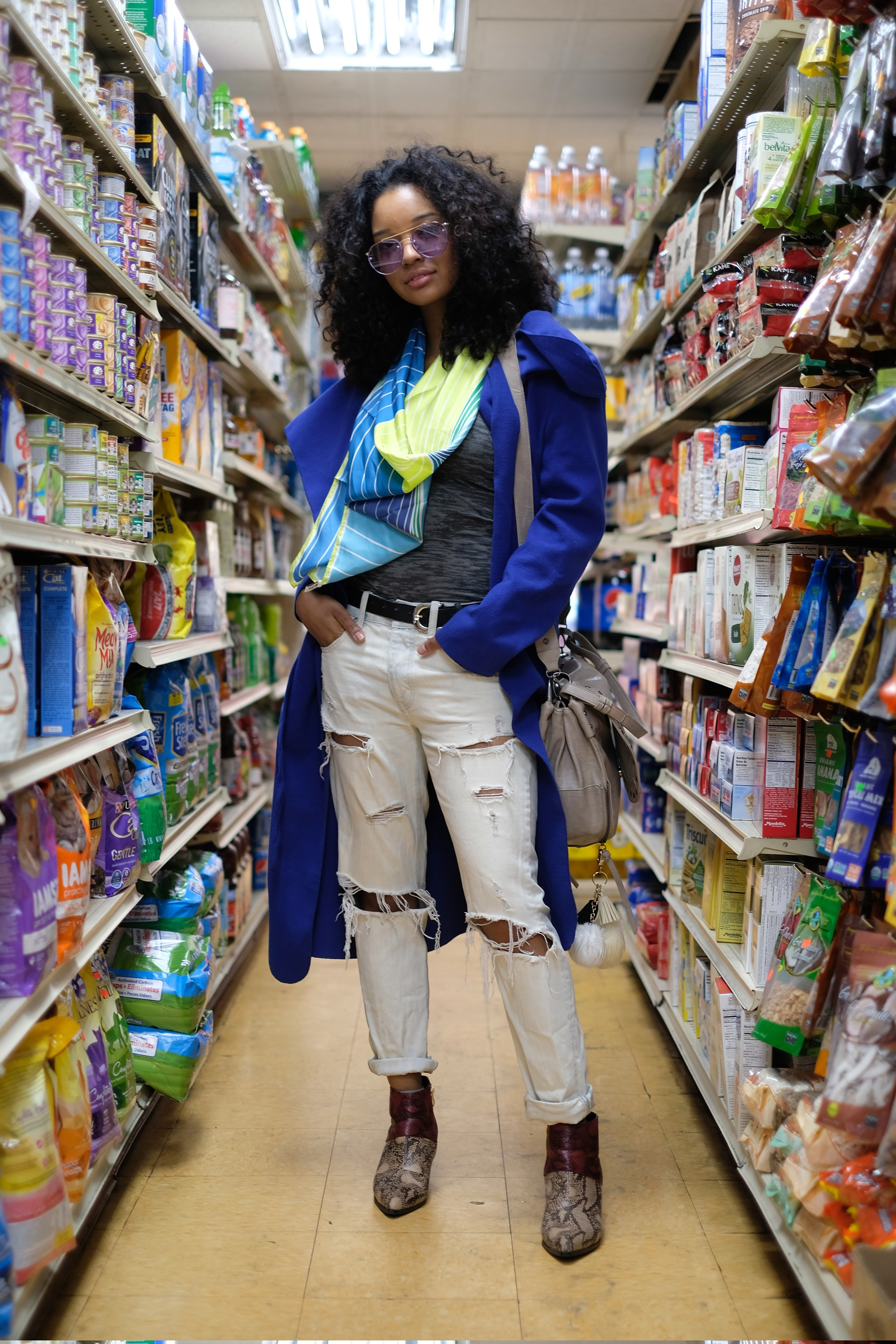 girl in blue coat in store aisle