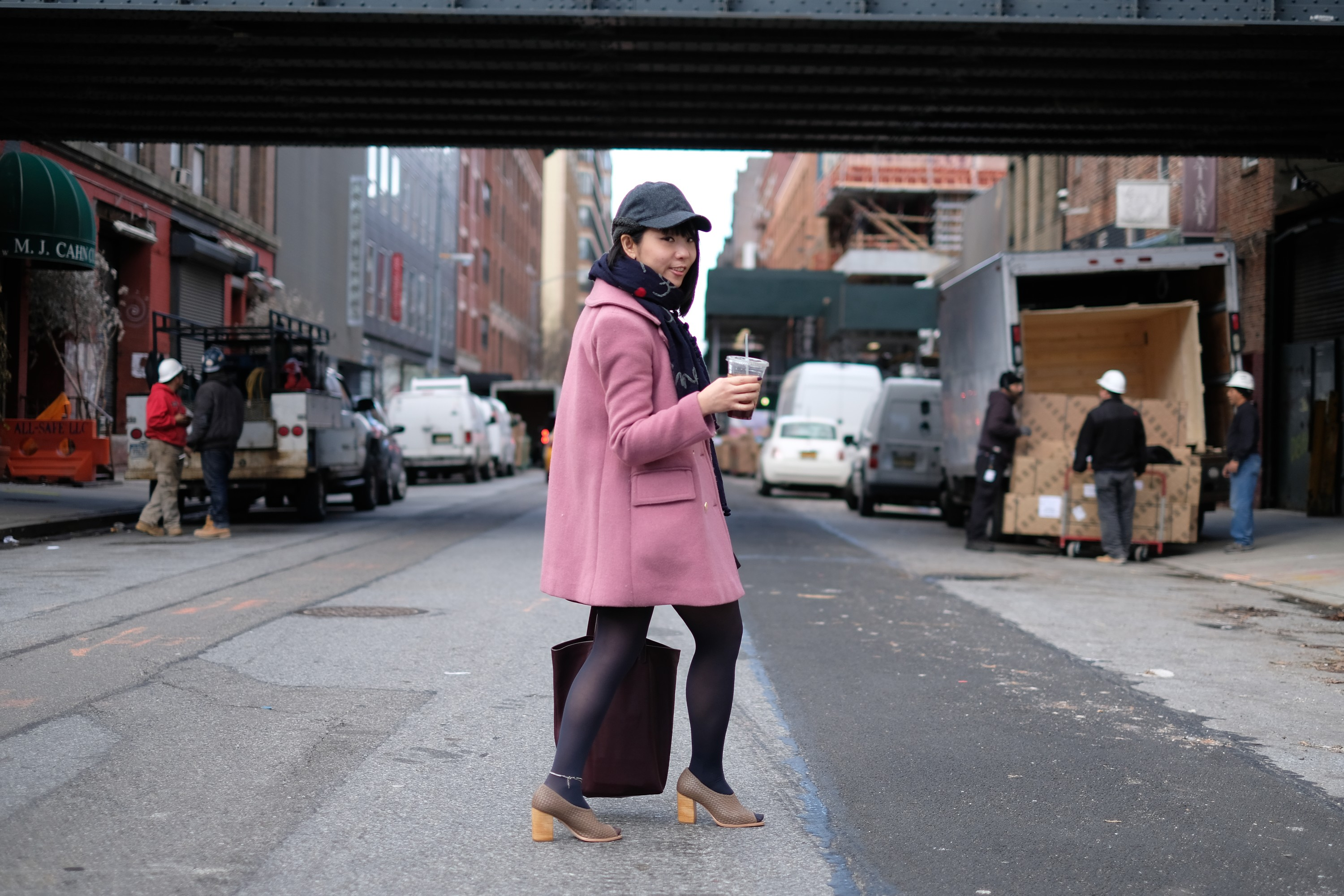 japanese girl in pink coat on city street
