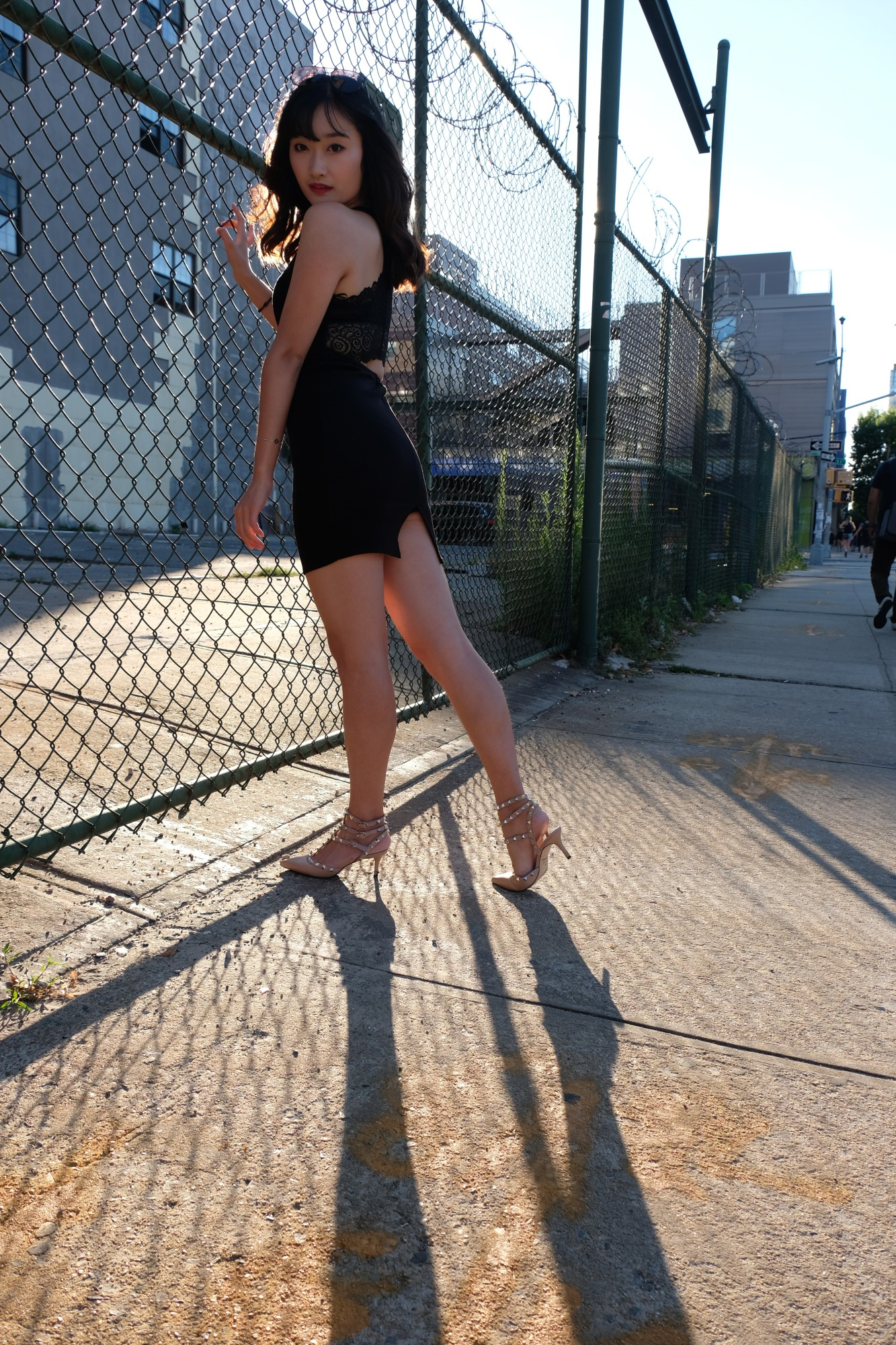 Chinese model by chain link fence
