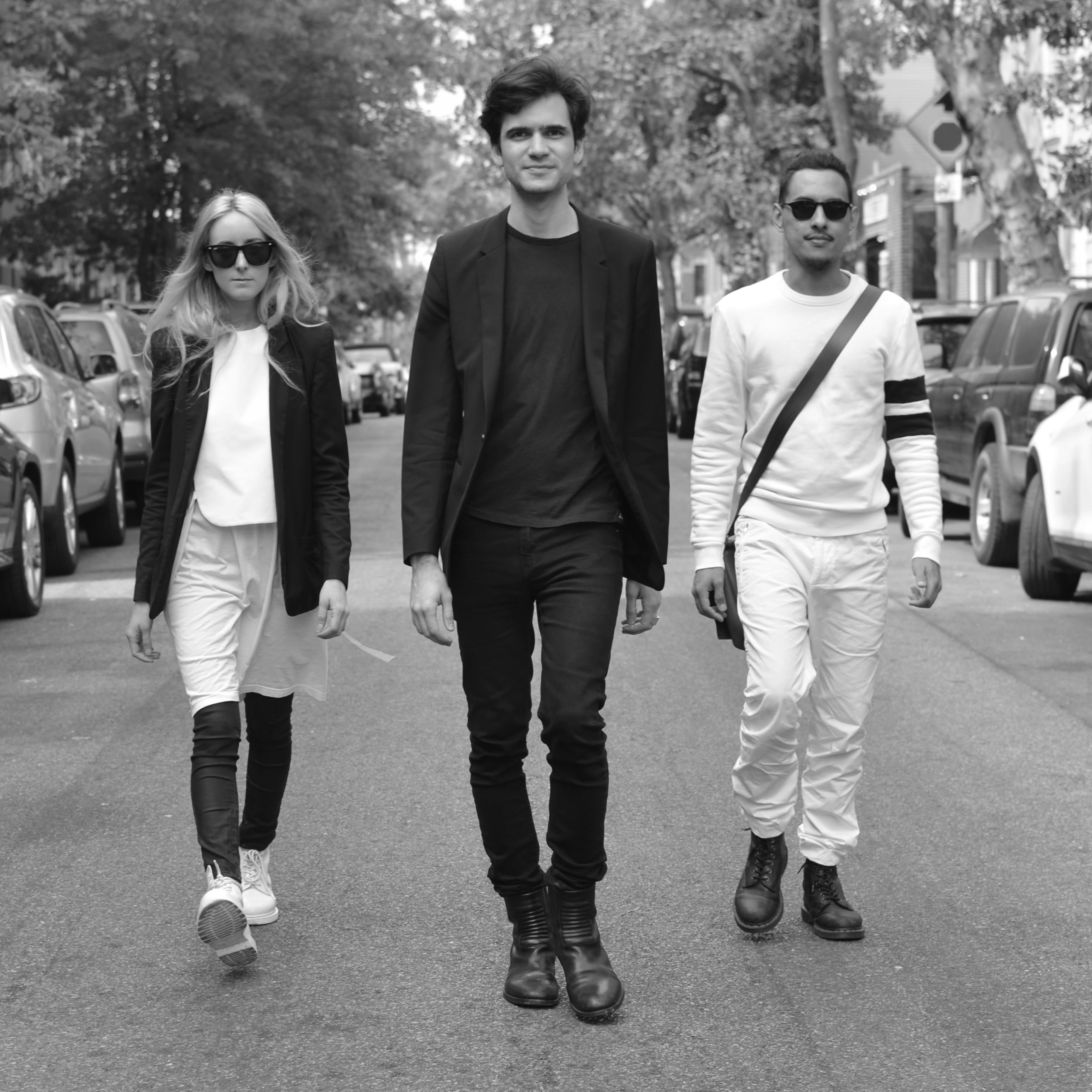 three people walking on NYC street