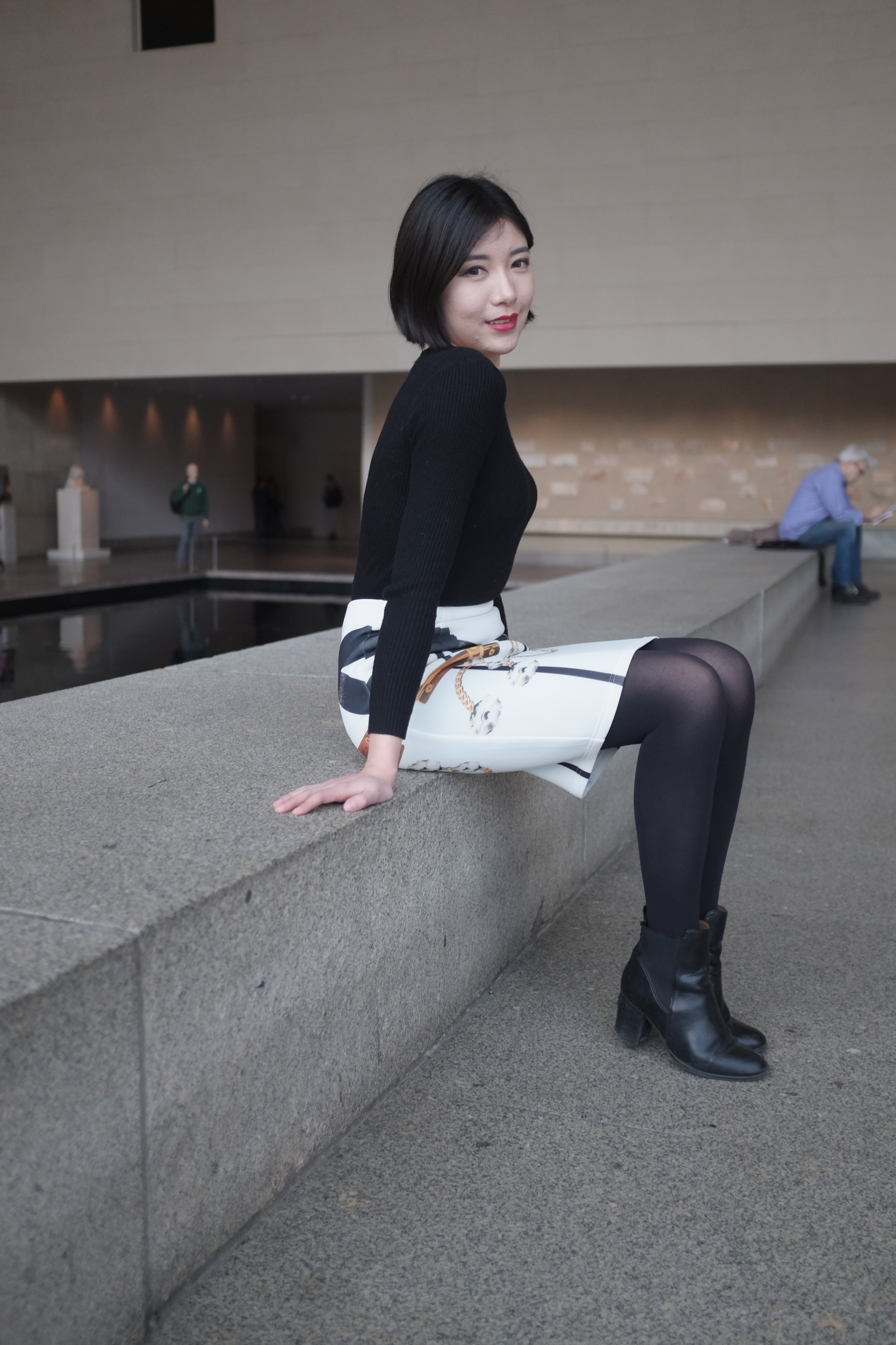 girl in black and white outfit at museum