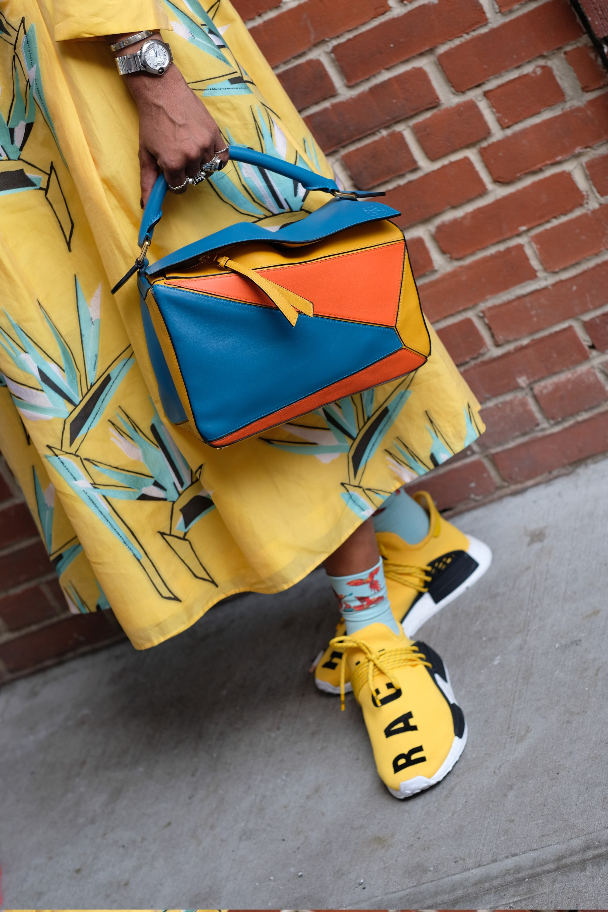 colorful bag and yellow outfit