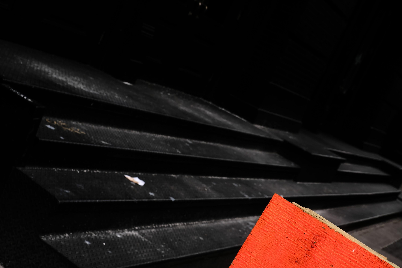 Orange Sign and Black Steps