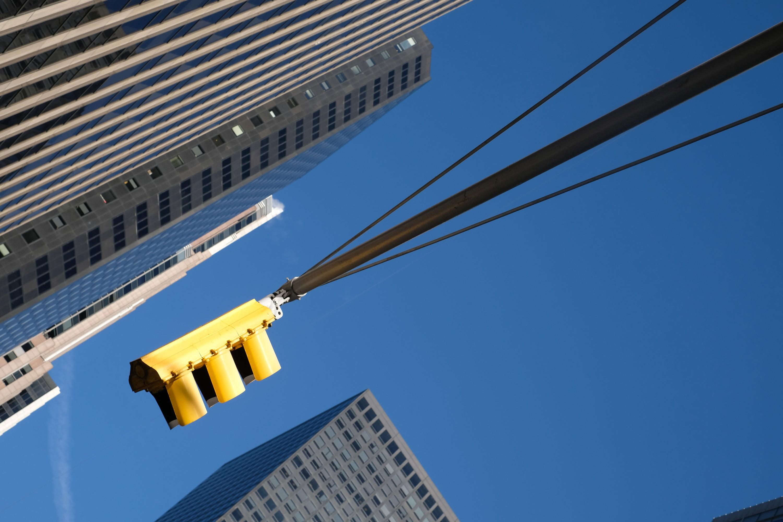 Yellow Traffic Light Against Blue Sky
