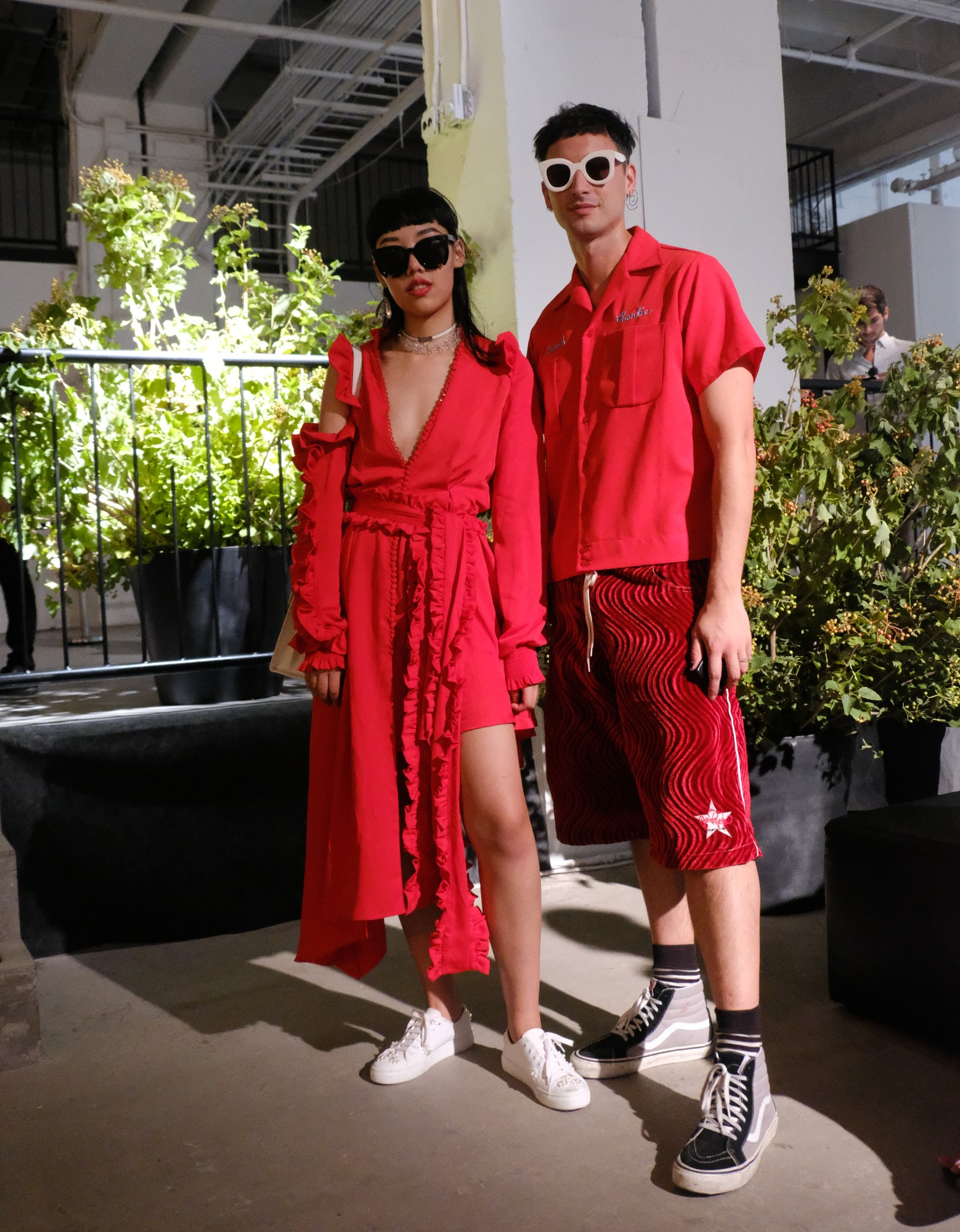 2 fashionistas dressed in red