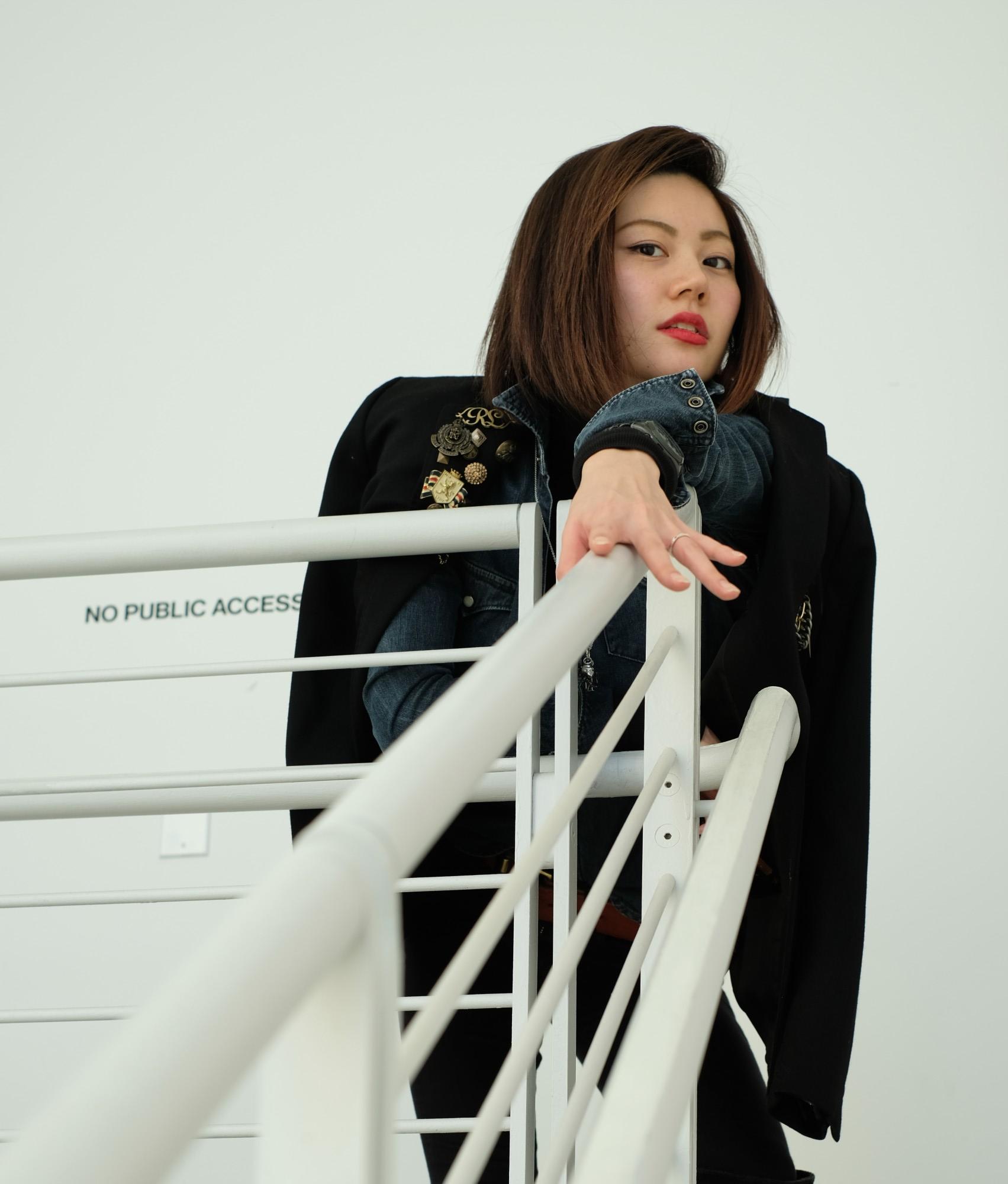 model on white staircase