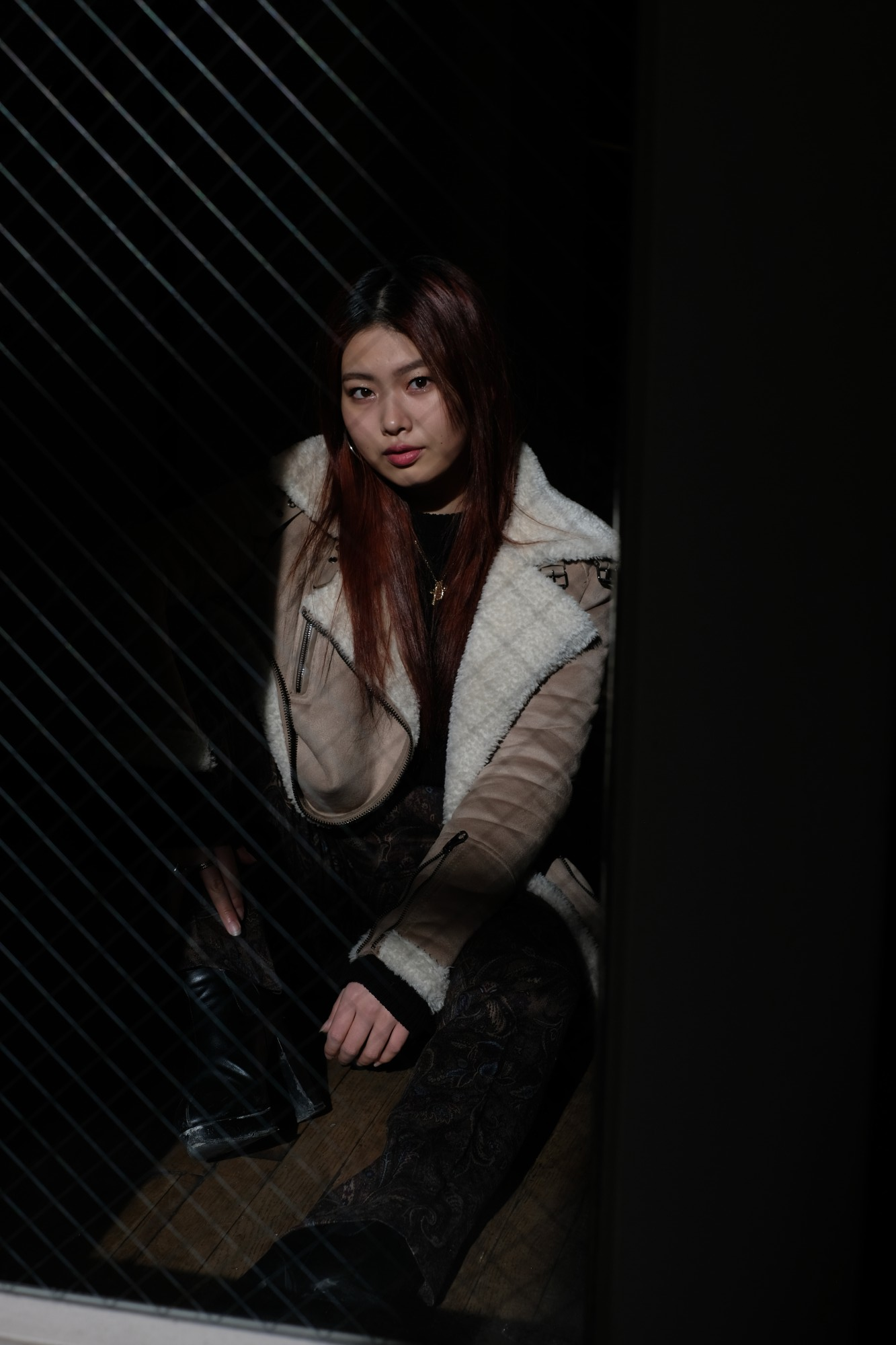 Japanese girl in black outfit and shearling jacket