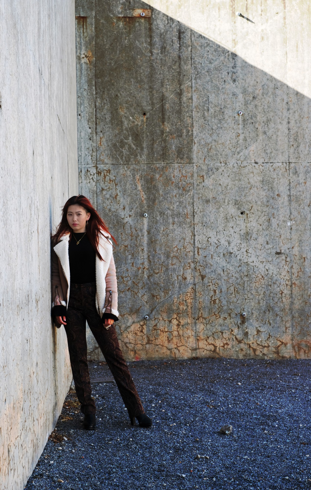Japanese girl by concrete walls