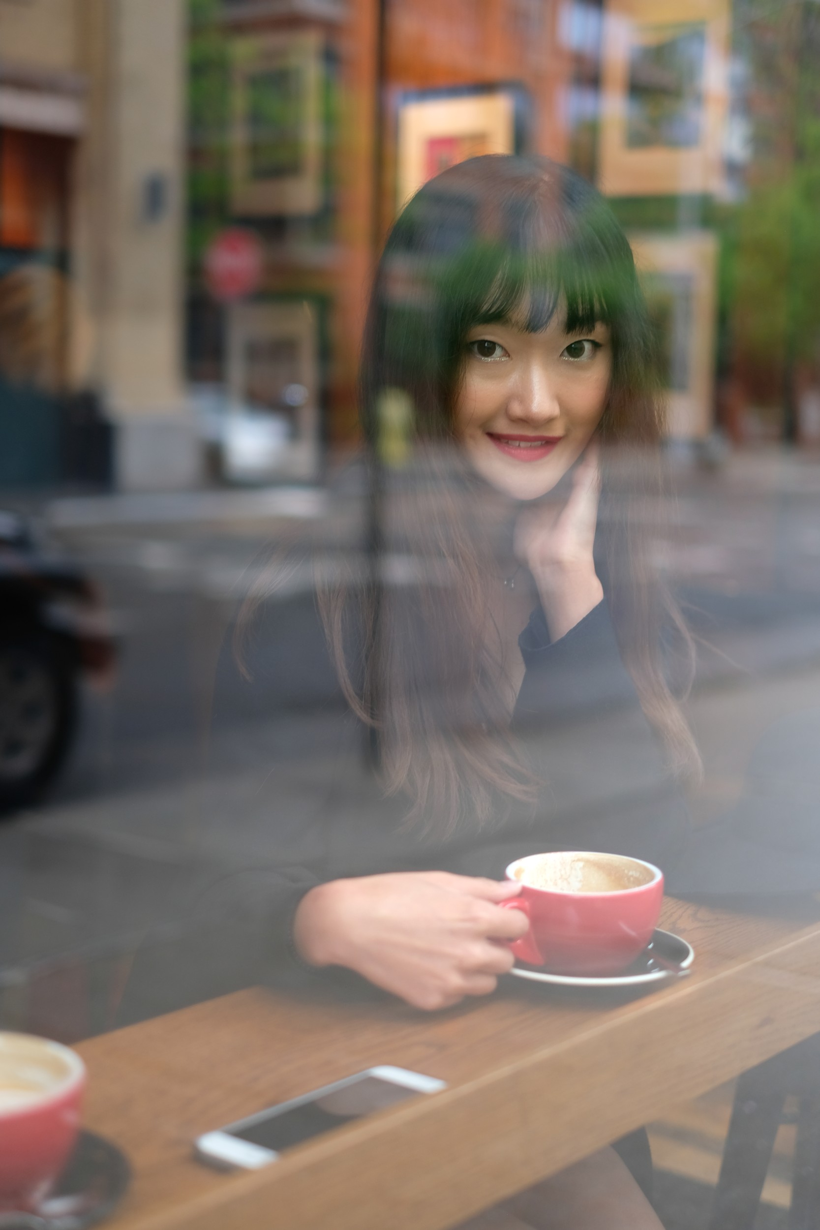 smiling girl looking through a window