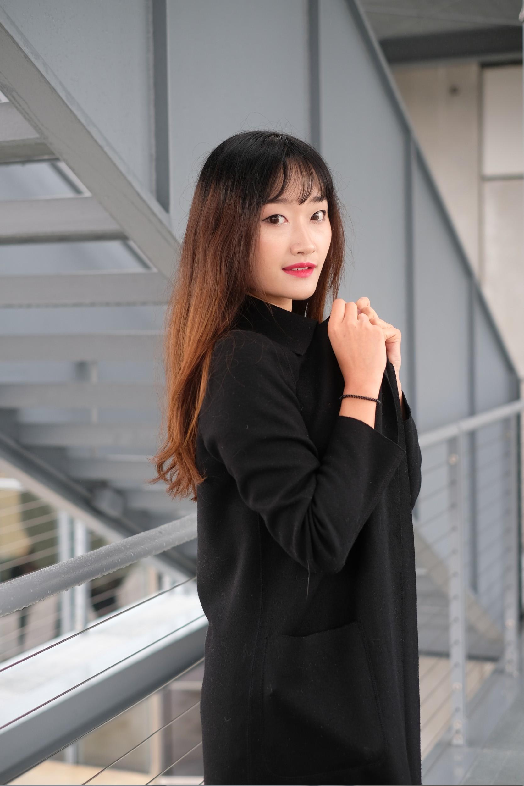 girl in black hat and coat