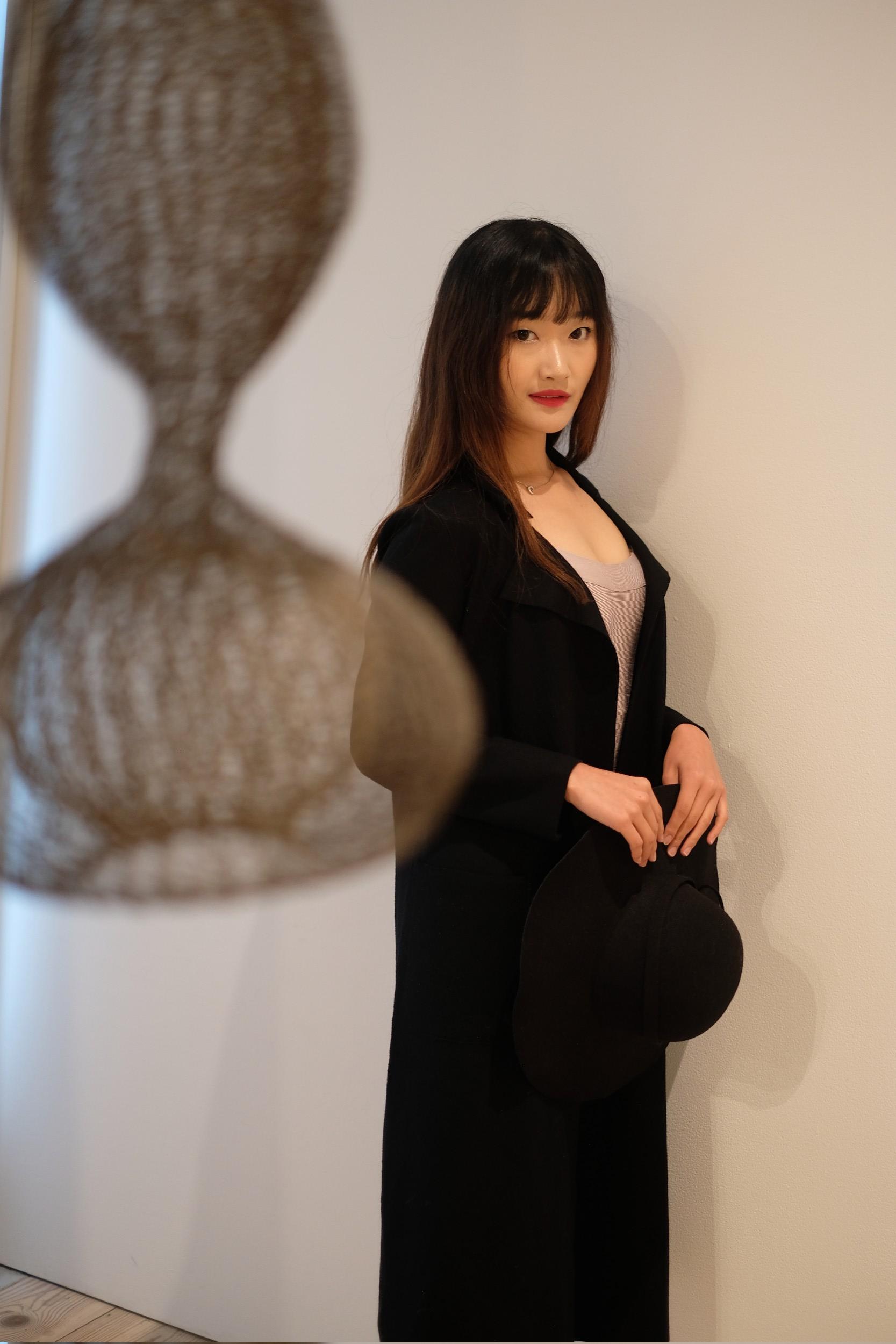 beautiful girl in black coat