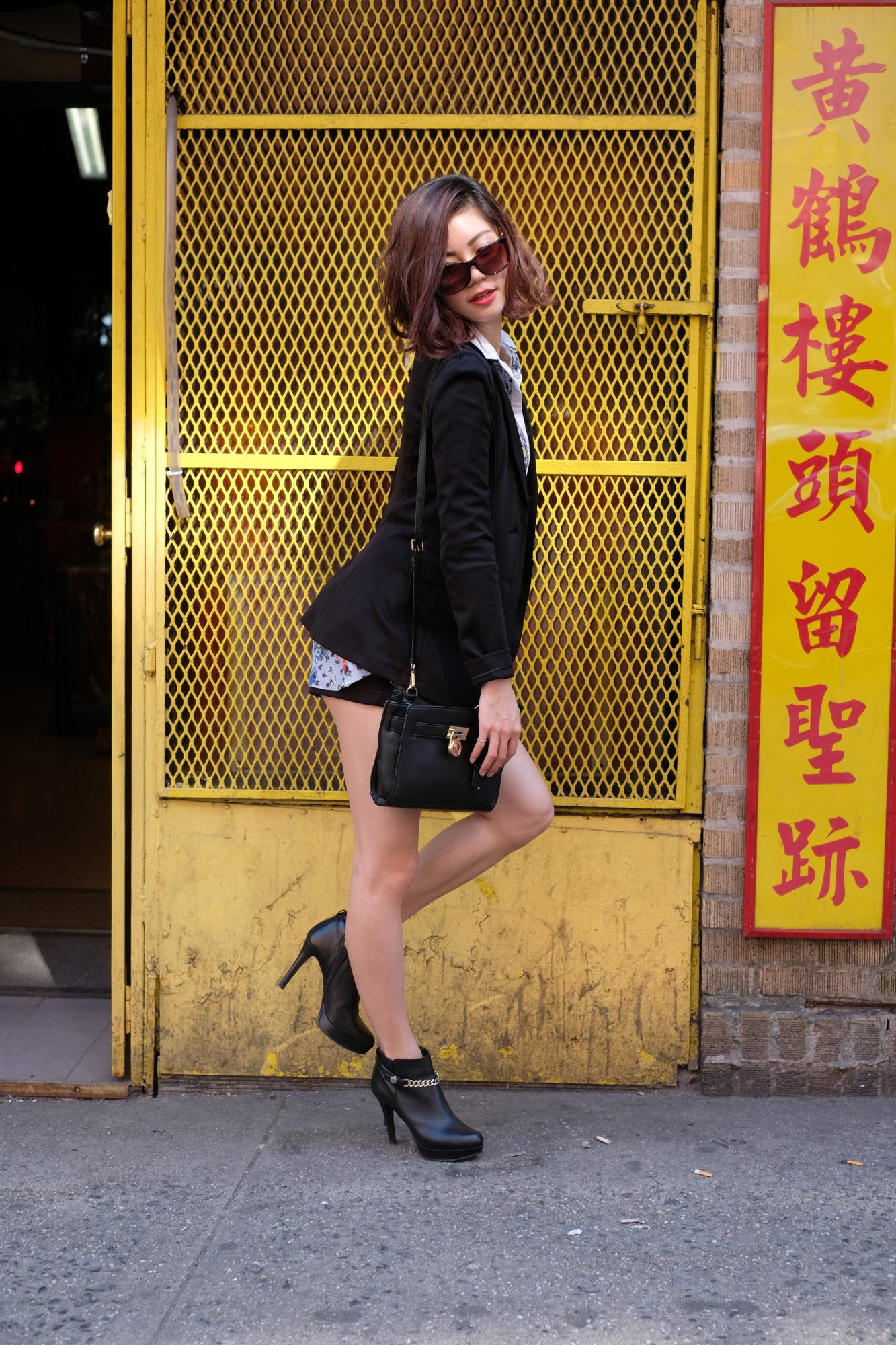 girl in black jacket by yellow background